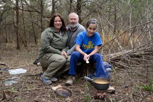 Ginger, Gary and Lanie cooking lunch on the Coleman Exponent stove during a day hike on the Sac River Trai