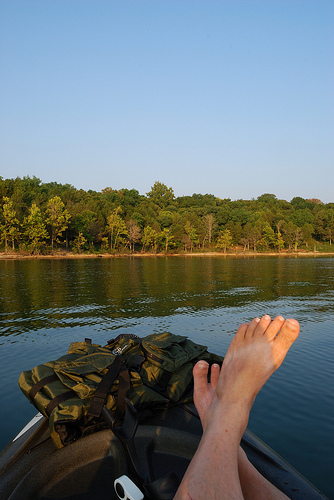 Kayaking with feet up in the water of Table Rock Lake at Big Bay Recreation Area near Shell Knob, Missouri.