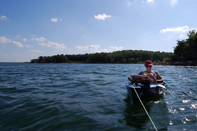Tied to an anchored Ascend FS10 kayak, Ginger reads in her D10 kayak while Gary fishes from his.