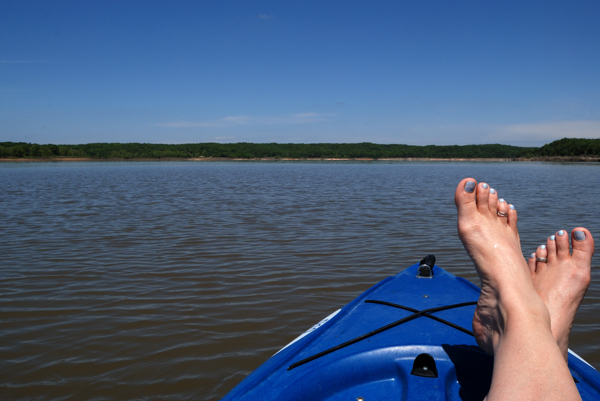 Sitting in my Ascend D10 Kayak with my feet up on a cloudless day on Truman Lake.