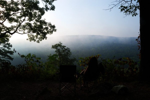 Photograph of Ginger Davis Allman watching the sun rise over the Huzzah Valley