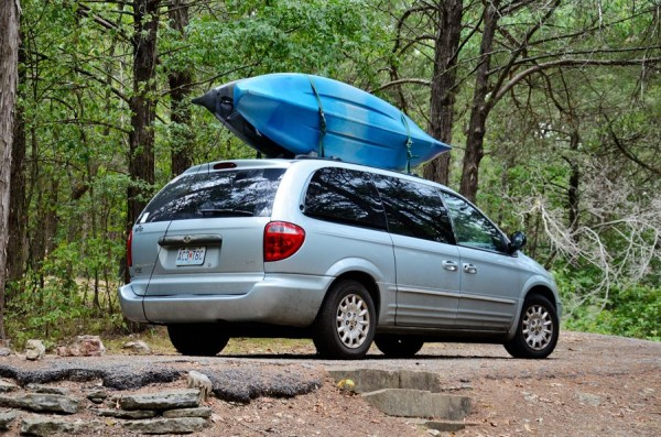A Town and Country Minivan with two Ascend kayaks on the top