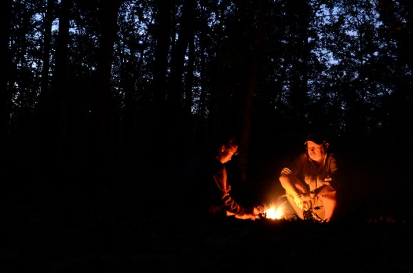 Gary and Lanie tending the campfire