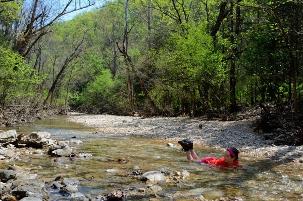 Photograph:cooling off in a creek during a hike at piney creek in the ozarks