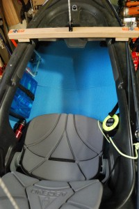 Picture showing a blue closed-cell foam sleeping mats being used to insulate the inside of an Ascend FS10 kayak