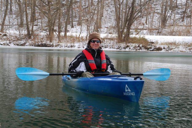 Photograph of Ginger davis Allman in her Ascend D10 Kayak on a partially frozen Lake Springfield, Springfield, Missouri