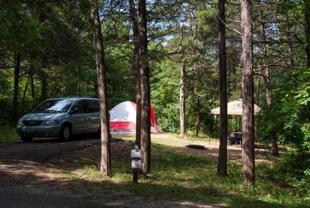 Photograph of a Minivan and tent at the Big Bay Campground, Shell Knob, Missouri