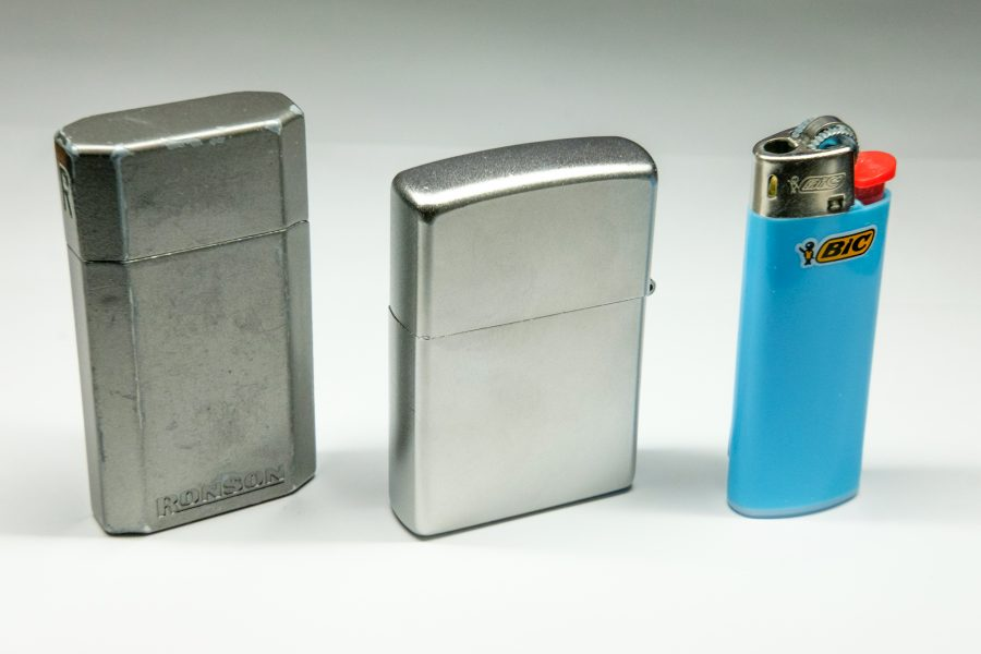 Photograph of a Ronson, Zippo and Bic Lighters - all suitable for use when camping and backpacking